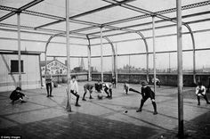 Urban playground: Schoolboys play with a ball on the rooftop playground