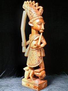 Sculpture by the late Akinlabi  Fakeye. Sold by www.grainsofafrica.com