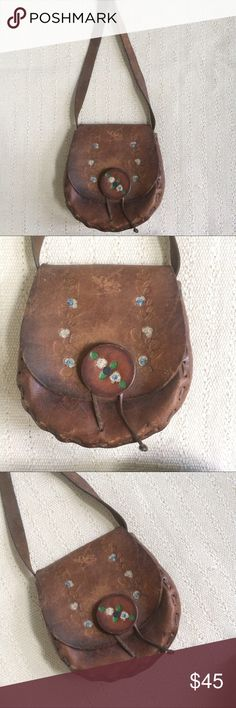Vintage 70s Festival Leather Tooled Bag Amazing leather 70s vintage purse with a tooled design of flowers and leaves. Can be worn cross body, however the strap is not adjustable. Scratches on the exterior, but overall it is in good condition. Perfect for the festival goer. Vintage Bags Crossbody Bags