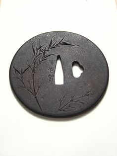 Goishi-Gata Tsuba (Tsuba plate of convex cross section resembling the stone used in the game of GO.) Bamboo done with Katakiri-bori