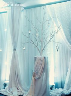 Stunning branches, crystal accents, draping, and lighting effects