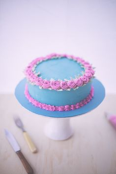 pink rosette cake decorated buttercream cake