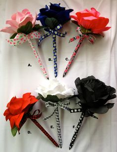 Ribbon wrapped pens, make with a black rose for decoration and then favors.
