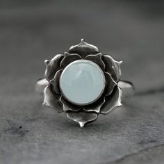 Aquamarine Lotus Ring Natural seafoam aquamarine is set in an opening lotus flower. Ive hand cut and layered sterling silver to create the lotus
