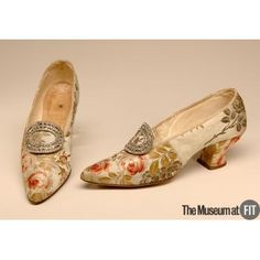 Silk brocade shoes with silver metal and rhinestones. England, 1910.