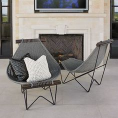 Sink deeply and relax into our Spinnaker Rattan Lounge Chair, which takes its name from a wind-filled sail. Hand-woven by artisans in Vietnam.