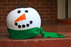 Still have a pumpkin on your front porch? Paint it white and transform it into a snowman! I LOVE THIS IDEA! #pumpkins #holidays