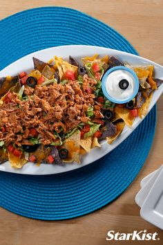 The perfect game day appetizer is just a few steps away! Try this delicious tuna nachos recipe for a healthy alTUNAtive twist to a game day classic.