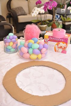 Homemade Easter Wreath:    75 plastic eggs  1 bag of Easter grass  pencil  hot glue gun  cardboard  ribbon to make your bow  12″ string