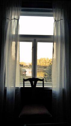 Villa interior. Light linen curtains Sea view. Archipelago. Finland.