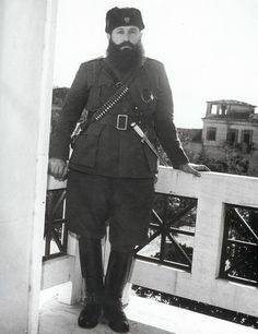 Aris Velouchiotis, the hero of the resistance, believes that taking part in the new government is capitulation and the only way to achieve the communist goal is through armed struggle. Ares Velouchiotis on the balcony at the Hotel Grande Bretagne from Ellada 1944 by Dmitri Kessel