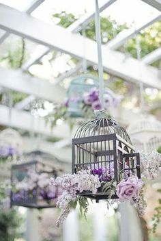 side decoration: cage with lots of Lavender and olive branches and some small yellow flowers