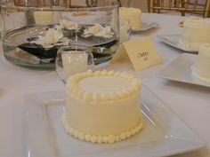 Individual cakes used as the centerpiece for the wedding tables. Four different flavors of cake and frosting for the guests to enjoy... - Sweets by Millie
