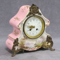 FRENCH DECORATED PORCELAIN CASED MANTLE CLOCK