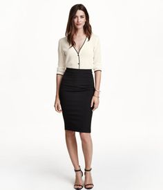 Knee-length, fitted pencil skirt in thick, woven fabric. Visible zip at back. Unlined.