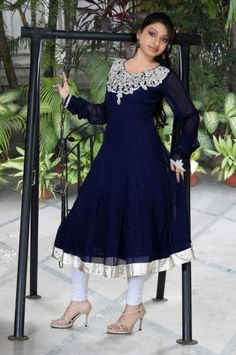 Dark blue full sleeve churidar suit with embroidery at neck and white golden lace at bottom. This latest designer salwar suit is perfect for wedding and party wear.