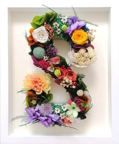 This custom letter is handcrafted in Ireland with real flowers that do not wilt because they're preserved. This is a best seller gift to wow your dear one with something unique and beautiful. Framed Letters, Preserved Flowers, Flower Letters, Makes You Beautiful, How To Preserve Flowers, Real Flowers, Customized Gifts, Preserves, A Table