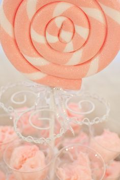 Cupcake stand displaying cups of pink cotton candy, accented with a huge styro-foam lollipop