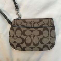 Coach bag Coach wristlet brown never used! unsure of the original price, just an estimation Coach Bags Clutches & Wristlets