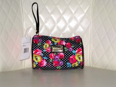 'BNWT Betsey Johnson Polka Floral Triangle Wristlet ' is going up for auction on Tophatter.