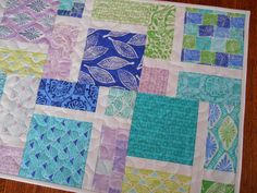 Quilted Table Runner in Blue Green and Lavender - Kate Spain Horizon Collection - Long Table Quilt - Quilted Table Mat - Table Topper by susiquilts on Etsy https://www.etsy.com/listing/215529635/quilted-table-runner-in-blue-green-and