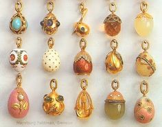 A Wonderful Showing of Miniature Faberge Egg Charms in Various Gems and Metals, Lovely.