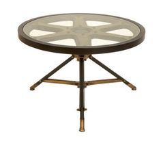 Metal accent table with a movie reel-inspired design and tripod base.Product: Accent tableConstruction Material: Metal and glassColor: Bronze and goldDimensions: H x DiameterCleaning and Care: Not recommended for outdoor use. Wipe with dry cloth. Movie Reels, Film Reels, Movie Film, Regency Furniture, Table Furniture, Upcycled Furniture, Industrial Furniture, Furniture Ideas, Glass Table