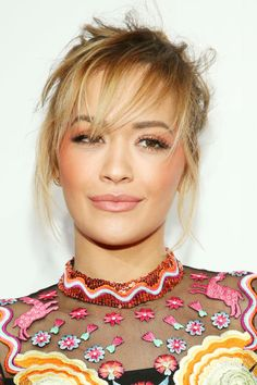 Rita Ora wears an apricot hue along her cheekbones in a C-shape up to her temples, and applied the same shade to her lids--perfect for a Valentine's Day day look.