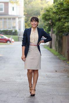 Blue Blazer, ruffled button down, gray skirt, brown skinny belt