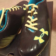 Under armour soccer cleats Worn a few times. Outdoor soccer shoes Under Armour Shoes Athletic Shoes