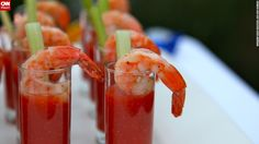 """""""When doing a theme party, it's easy to get tempted by every food idea,"""" said Campbell. """"Focus on what will taste good and be filling alongside all of those cocktails."""" Her 1920s progressive dinner included Caesar salad, shrimp cocktails and grilled rib-eyes."""