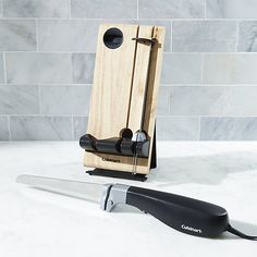 This one-touch, pressure-activated electric knife with a powerful motor carves through meats, poultry and tough vegetables and slices, crusty, delicate loaves with a separate bread blade. Contoured handle provides a secure, comfortable grip in either hand. Wood docking station adds a striking countertop presence.
