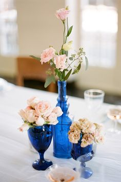 Blue Wedding Centerpieces different flowers, but blue vases--possibly? If we have a white table cloth. Blue Wedding Centerpieces, Glass Centerpieces, Reception Decorations, Centerpiece Ideas, Vase Ideas, Tall Centerpiece, Wedding Themes, Wedding Colors, Wedding Ideas