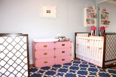We're crushing on this pink campaign dresser in this fab twin girl nursery!