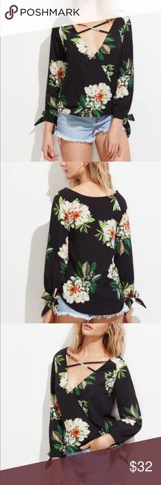 Criss Cross Floral Blouse Super cute!  Polyester with bow sleeves and a V-neck.  Measurements posted above. Tops Blouses