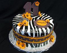 Zebra cake with orange flowers by thecakeattic.com in Salisbury, NC www.facebook.com/thecakeattic