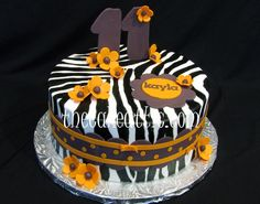 Zebra cake with orange flowers by thecakeattic.com in Salisbury, NC www.facebook.com/thecakeattic