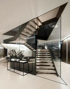 The Orum Residence by SPF:architects A large and sculpture staircase made of metal and glass is central to this modern house. The Orum Residence by SPF:architects A large and sculpture staircase made of metal and glass is central to this modern house. Glass Stairs Design, Home Stairs Design, Dream Home Design, Staircase Design Modern, Glass House Design, Interior Staircase, Stair Design, Design Exterior, Dream House Interior