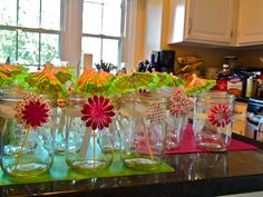 Mason Jar decor for pink and green shower! Did this or a wedding shower last year, ribbon and paper flowers from Michaels