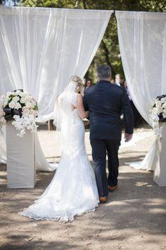 Grand entrance ideas for an outdoor wedding: curtains   Photo: Braedon Photography
