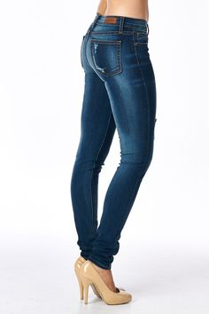 """- 73.5% Cotton/ 16% Polyester/ 9% Rayon/ 1.5 % Spandex - Made in USA - Distressed detailed - RISE :8"""" INSEAM : 32"""" COTTON/RAYON/POLY/SPANDEX - Button Fly closure, Skinny Fit, Relaxed Skinny Mid Waist"""