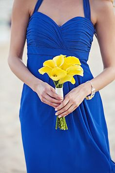blue and yellow wedding, bridesmaid's bouquet and blue dresses. Photography by…