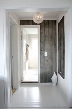 Stain the wood gray? I love this vertical barn board look on the wall. Could even add to a grey toned house with a warmer wood color to add warmth to a space; Home Renovation, Home Remodeling, Style At Home, Wood Paneling, Wood Walls, Painted Floors, Timber Walls, Wood Stairs, Panelling