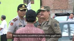 this is a video of an Indonesian muslim community and the police trying to stop a small group of christians from having a mass (while squatting down in the rain on the side of the road outside a closed gate where their church used to be) because the legal system has failed to protect the minorities' right to hold their religious belief by closing down their church, muslim and indonesian don't act like this, only stupid people who think and act like this . .