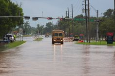 Texas National Guard Light Medium Tactical Vehicle (LMTV) making it's way down a flooded road to search for flood victims. Texas Guardsmen evacuated Texans in need from severe flooding in Fort Bend County, Texas, June 2, 2016. Texas Guardsmen supported local first responders during search and rescue operations following severe weather. (Texas State Guard photo by Staff Sgt. Timothy Pruitt/ Released)