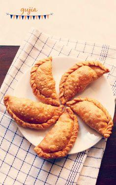 gujiya recipe - crisp flaky pastry stuffed with a sweet khoya filling. sharing both fried and baked version of gujiya for diwali festival.