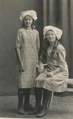 Two beaming Scandinavian girls. Love the traditional hats. I long for the return of the bonnet. I'd be rocking one every day.