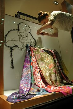 Debbie Smyth putting the final touches to one of her window displays at Hermes.