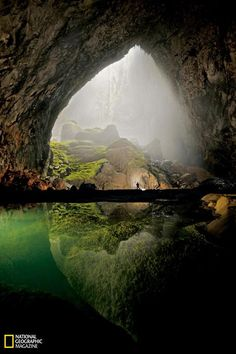 """Infinite Cave in Vietnam - the largest cave on earth, formed two to five million years ago, discovered in 2009 - """"300 feet wide, the ceiling nearly 800 feet tall: room enough for an entire New York City block of 40-story buildings. There are actually wispy clouds up near the ceiling.(...) tower of calcite on the cave floor that is more than 200 feet tall, smothered by ferns, palms, and other jungle plants."""" It has a large fast-flowing underground river inside."""