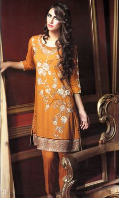 Shop Orange Embroidered Cambric Linen Salwar Kameez by Motifz Clothes Winter Collection